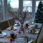 Table setting in white, gold, silver & reds