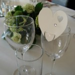 Ivory heart place card on wine glass
