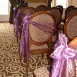 Purple organza lining ceremony aisle